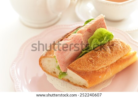 Homemade luncheon meat and lettuce sandwich with English tea on background - stock photo