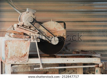 Homemade machine for cutting stone in a small workshop - stock photo