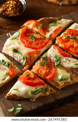 Homemade Margarita Flatbread Pizza with Tomato and Basil - stock photo