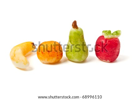 Homemade Marzipan Fruit cake decorations of banana, apple, orange and pear isolated on white. - stock photo