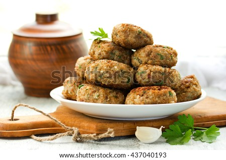Homemade meat cutlets, delicious baked pork cutlets in crispy breading - stock photo