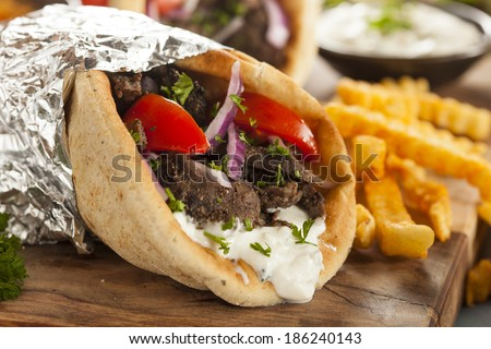 Homemade Meat Gyro with Tzatziki Sauce, tomatos and French Fries - stock photo