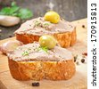 Homemade meat snack chicken liver pate with savory and olives - stock photo