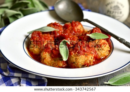 Homemade meatballs in tomato sauce with sage.Rustic style. - stock photo