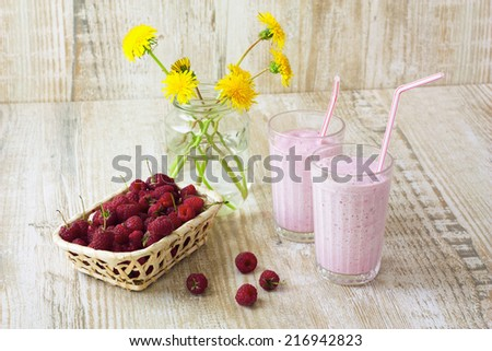 homemade milkshakes and fresh raspberries - stock photo