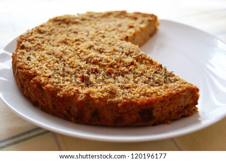 Homemade millet pie mixed with pumpkin and onion in white dish - stock photo