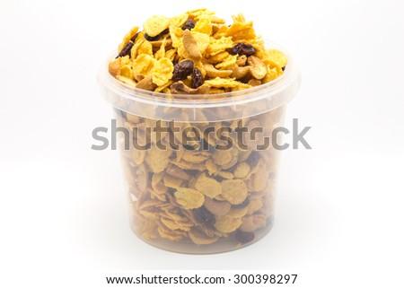 Homemade mixed caramel cornflakes on white background  - stock photo