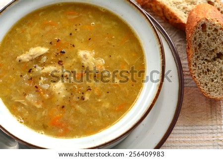 Homemade nourishing chicken vegetable soup in horizontal format - stock photo