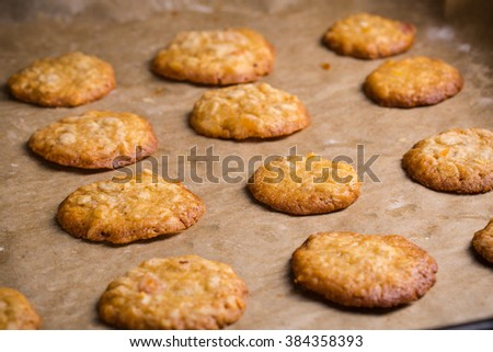 Homemade oat cookies on baking tray for breakfast. - stock photo