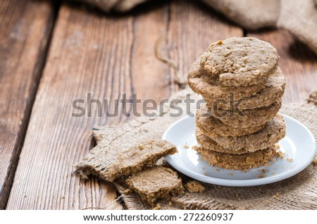 Homemade Oat Cookies on wooden background (close-up shot) - stock photo