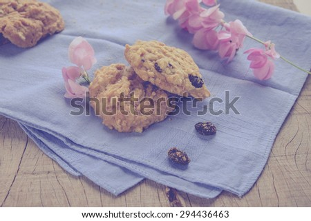 Homemade oatmeal cookies  on wooden background. Vintage effect filter style pictures - stock photo