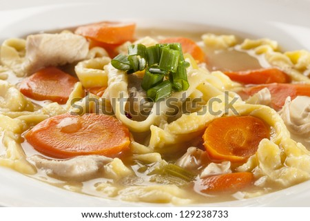 Homemade Organic Chicken Noodle Soup with celery and carrots - stock photo