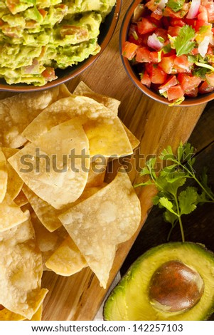 Homemade Organic Guacamole made with avacados and Tortilla Chips - stock photo