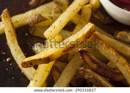 Homemade Oven Baked French Fries with Ketchup - stock photo