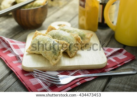 Homemade pan fried dumplings with Soy Sauce - stock photo