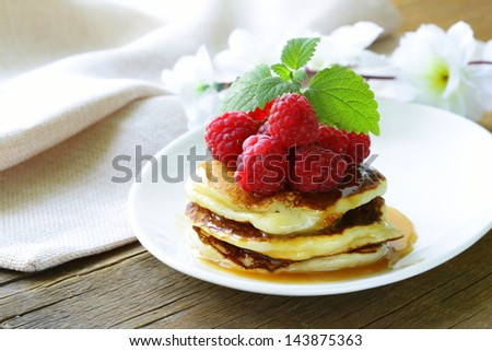 homemade pancakes with berries and mint - a delicious and healthy breakfast - stock photo