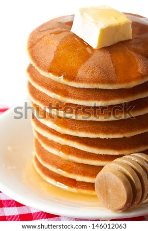 Homemade pancakes with honey and butter close up. - stock photo
