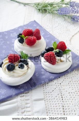 Homemade pavlova meringue cake with fresh berries and whipped cream. Morning. Dessert. - stock photo