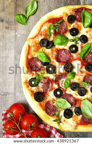 Homemade pepperoni pizza on a rustic wooden background.Top view. - stock photo