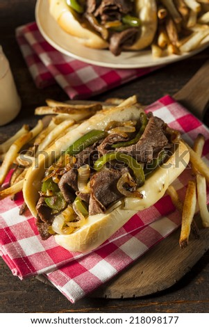 Homemade Philly Cheesesteak Sandwich with Onions and Peppers - stock photo