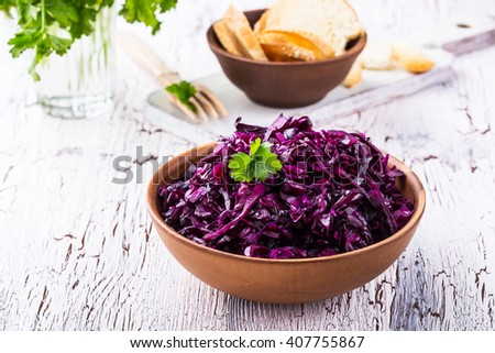 Homemade pickled red cabbage in ceramic bowl - stock photo