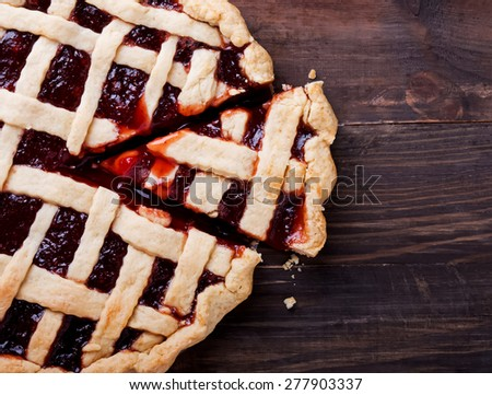 Homemade pie with jam on the wooden table, top view - stock photo