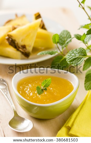 Homemade pineapple jam with mint leaves for breakfast - stock photo