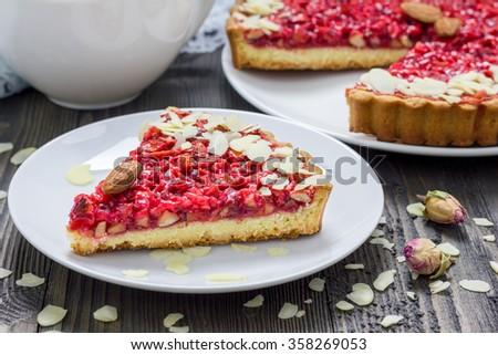 Homemade pink praline tart, almond tart. - stock photo