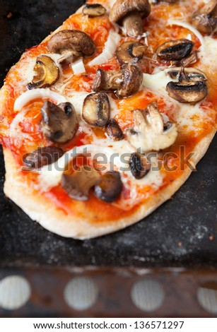 homemade pita with tomato and mushroom filling on top, food - stock photo
