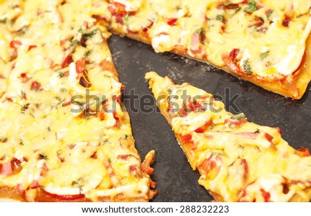 homemade pizza cut into slices on a tray - stock photo