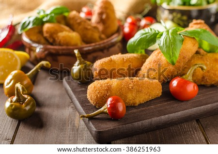 Homemade potato croquettes with cheese and chilli, very simple to do and delicious - stock photo