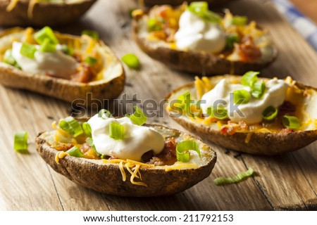 Homemade Potato Skins with Bacon Cheese and Sour Cream - stock photo