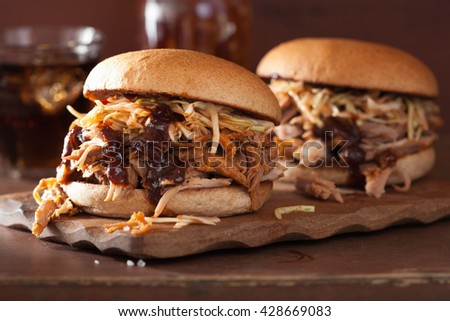 homemade pulled pork burger with coleslaw and bbq sauce - stock photo