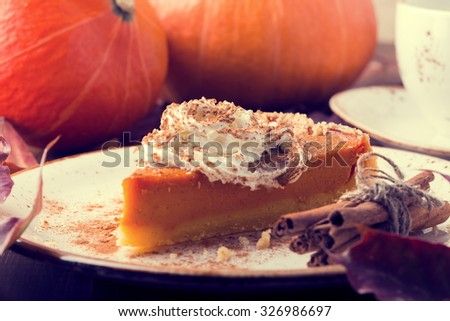 Homemade Pumpkin Pie for Thanksgiving. Selective focus, toned. - stock photo