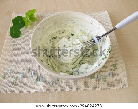 Homemade quark with herbs - stock photo