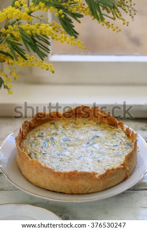 Homemade quiche filled with cheese, ham and leek. Selective focus. - stock photo
