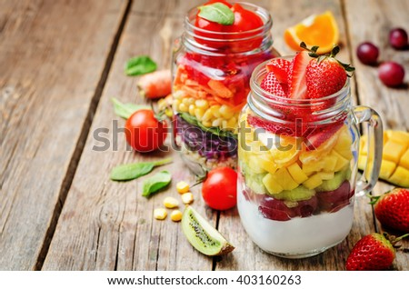 homemade rainbow salads with vegetables, quinoa, Greek yogurt and fruit. toning. selective focus - stock photo