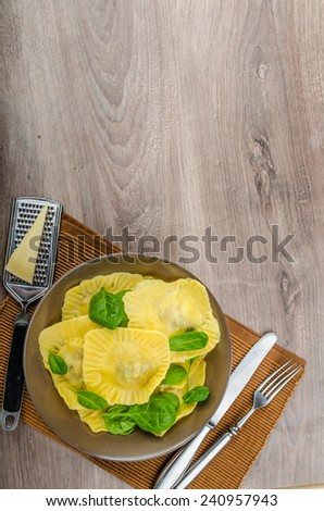 Homemade ravioli stuffed with spinach and ricotta, all home prepared - stock photo