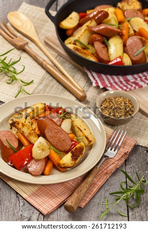 Homemade Roasted Sausages and Potato Dinner. Selective focus. - stock photo