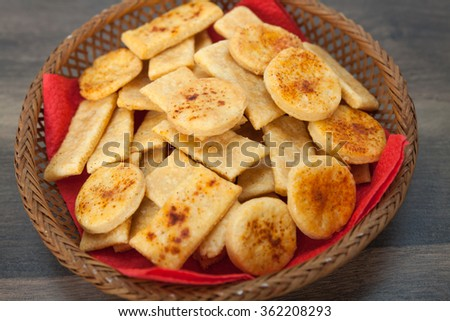 Homemade salty crackers with red paprika on top - stock photo