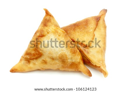 Homemade samosas on a white background - stock photo