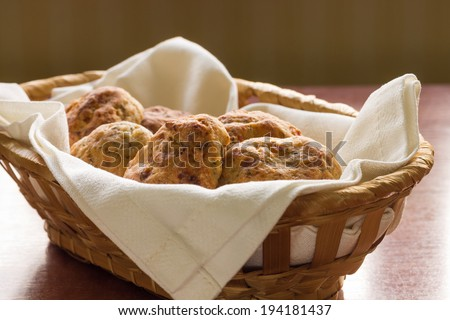 Homemade scones in a wicker basket - stock photo