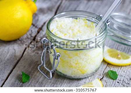 Homemade scrub made of sea salt, lemon peel and lemon juice - stock photo