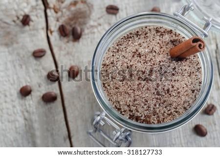 Homemade scrub made of sugar, ground coffee and cinnamon powder (top view) - stock photo