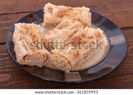 Homemade semolina and cinnamon cake - stock photo
