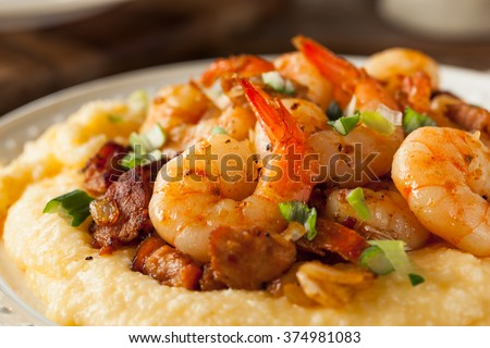 Homemade Shrimp and Grits with Pork and Cheddar - stock photo