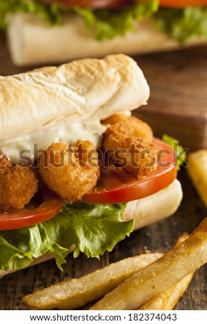 Homemade Shrimp Po Boy Sandwich with French Fries - stock photo