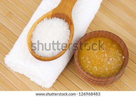 Homemade skin exfoliant (skin scrub) of sea salt and honey - stock photo