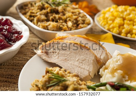 Homemade Sliced Turkey Breast for Thanksgiving Dinner - stock photo