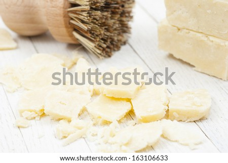 homemade soaps, environmental cleansers on white wood background - stock photo